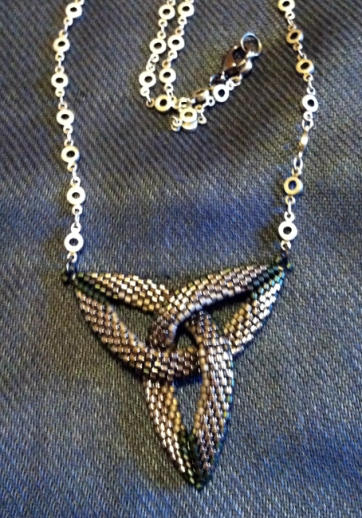 Trefoil celtic symbol - peyote-stitched delica seed beads, attached silver chain.